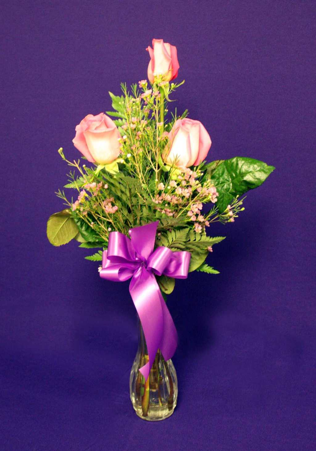 Pink Roses with purple ribbon floral arrangement from Mon General Hospital Gift Shop