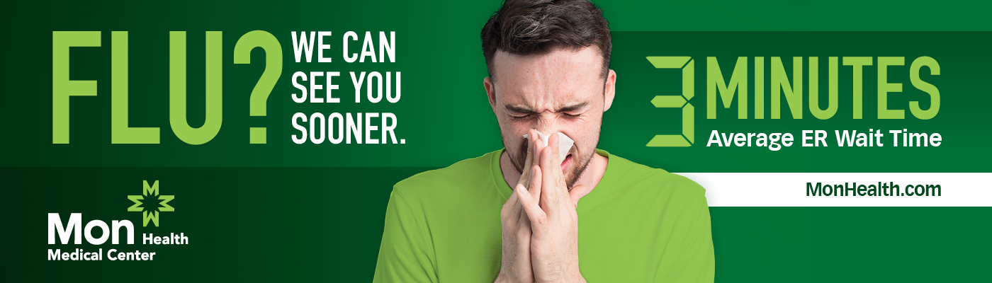 man blowing nose with flu